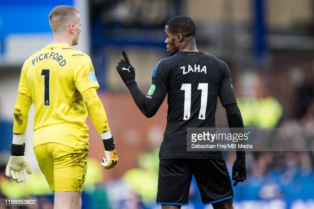 Jordan Pickford of Everton FC and Wilfried Zaha of Crystal Palace during the Premier League match between Everton FC and Crystal Palace at Goodison...