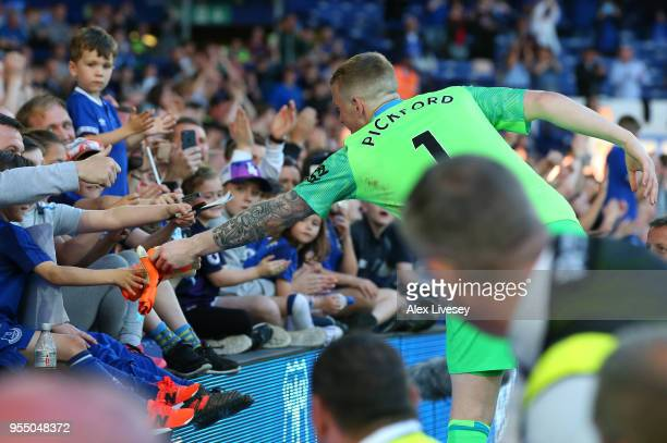 Jordan Pickford of Everton gives his gloves to a young fan during the Premier League match between Everton and Southampton at Goodison Park on May 5...