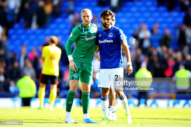 Jordan Pickford of Everton hugs teammate Andre Gomes after the Premier League match between Everton FC and Watford FC at Goodison Park on August 17,...