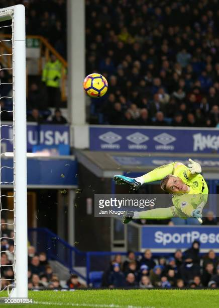 Jordan Pickford of Everton looks back as he watches the shot of Juan Mata of Manchester United hit the post during the Premier League match between...