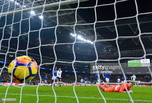 Jordan Pickford of Everton looks dejected as Christian Eriksen of Tottenham Hotspur scores his sides fourth goal during the Premier League match...
