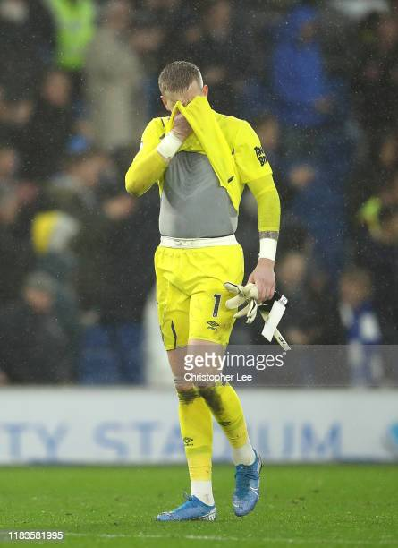 Jordan Pickford of Everton looks dejected following his sides defeat in the Premier League match between Brighton Hove Albion and Everton FC at...