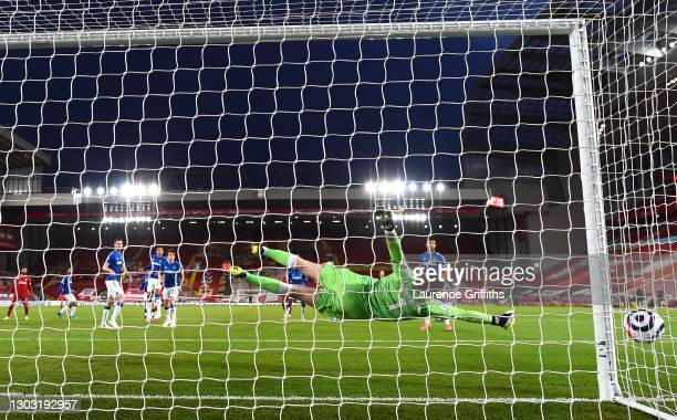 Jordan Pickford of Everton makes a save during the Premier League match between Liverpool and Everton at Anfield on February 20, 2021 in Liverpool,...