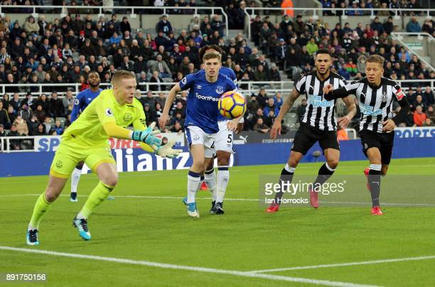 Jordan Pickford of Everton makes a save during the Premier League match between Newcastle United and Everton at St James' Park on December 13 2017 in...