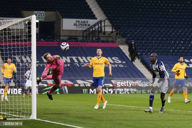 Jordan Pickford of Everton makes a save from a header by Mbaye Diagne of West Bromwich Albion during the Premier League match between West Bromwich...