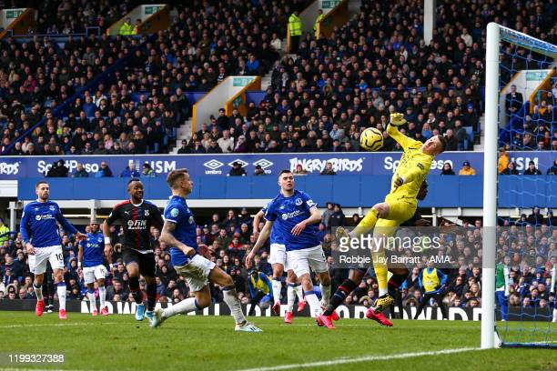 Jordan Pickford of Everton makes a save from Christian Benteke of Crystal Palace during the Premier League match between Everton FC and Crystal...