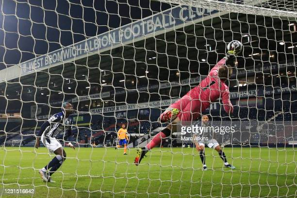 Jordan Pickford of Everton makes a save from Mbaye Diagne of West Bromwich Albion during the Premier League match between West Bromwich Albion and...