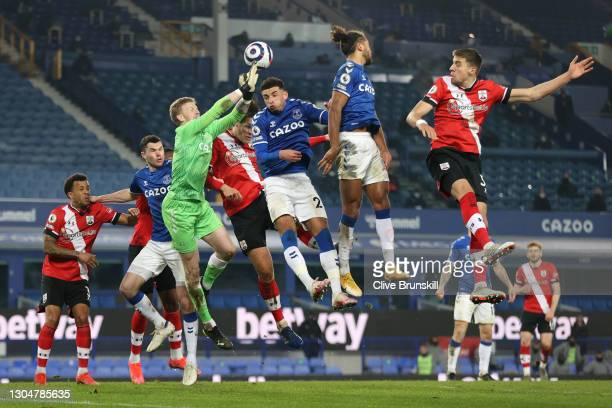 Jordan Pickford of Everton punches the ball away from Jannik Vestergaard of Southampton during the Premier League match between Everton and...