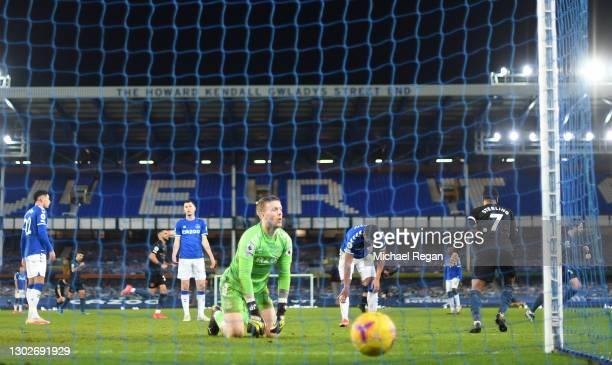 Jordan Pickford of Everton reacts after Manchester City's third goal scored by Bernardo Silva during the Premier League match between Everton and...