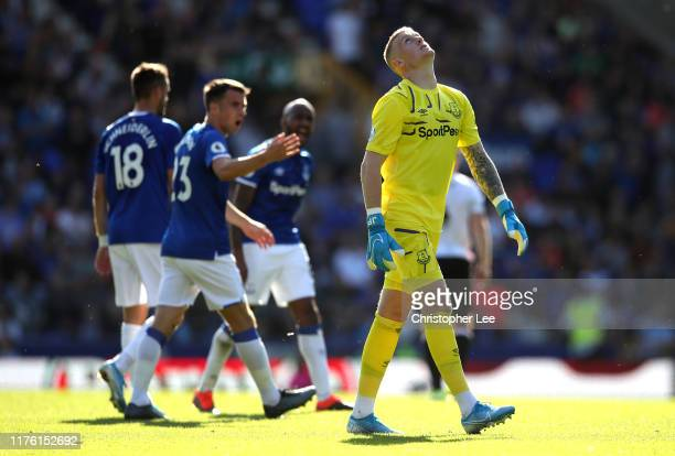 Jordan Pickford of Everton reacts as Yerry Mina scores an own goal for Sheffield United's first goal during the Premier League match between Everton...