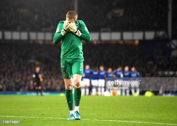 Jordan Pickford of Everton reacts during the penalty shootout in the Carabao Cup Quarter Final match between Everton FC and Leicester FC at Goodison...