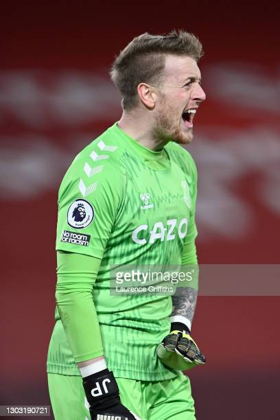 Jordan Pickford of Everton reacts during the Premier League match between Liverpool and Everton at Anfield on February 20, 2021 in Liverpool,...