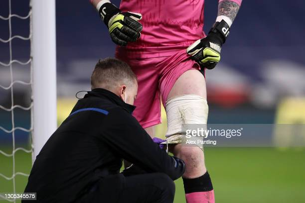 Jordan Pickford of Everton receives medical treatment during the Premier League match between West Bromwich Albion and Everton at The Hawthorns on...