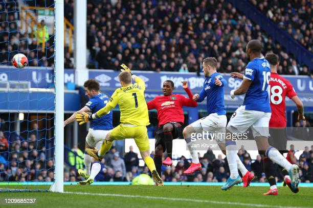 Jordan Pickford of Everton saves a shot from Odion Ighalo of Manchester United during the Premier League match between Everton FC and Manchester...