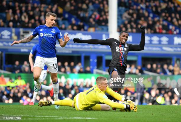 Jordan Pickford of Everton saves a shot from Wilfried Zaha of Crystal Palace during the Premier League match between Everton FC and Crystal Palace at...