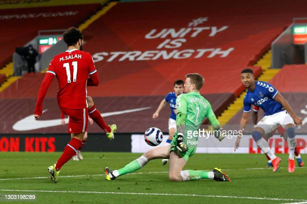 Jordan Pickford of Everton saves from Mohamed Salah of Liverpool during the Premier League match between Liverpool and Everton at Anfield on February...