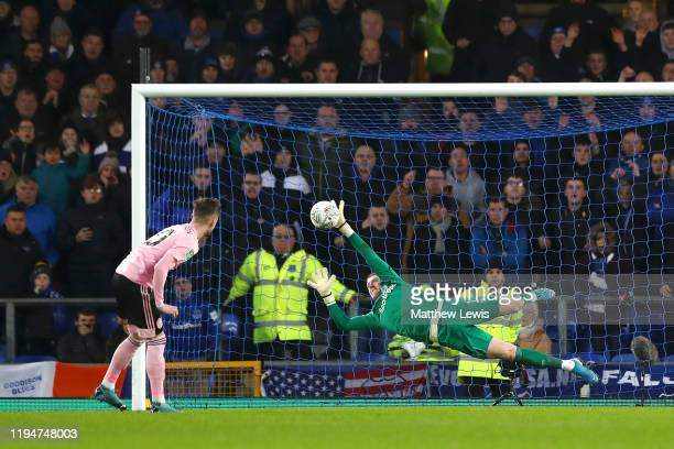 Jordan Pickford of Everton saves James Maddison of Leicester City's penalty during the Carabao Cup Quarter Final match between Everton FC and...