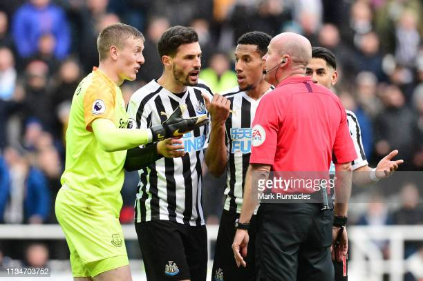 Jordan Pickford of Everton speaks with match referee Lee Mason after a penalty is given to Newcastle United during the Premier League match between...