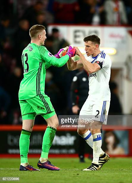Jordan Pickford of Sunderland and Billy Jones of Sunderland celebrate after the final whistle during the Premier League match between AFC Bournemouth...