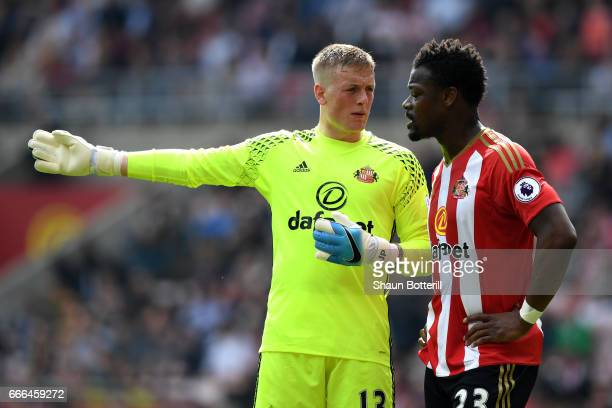 Jordan Pickford of Sunderland talks to Lamine Kone during the Premier League match between Sunderland and Manchester United at Stadium of Light on...