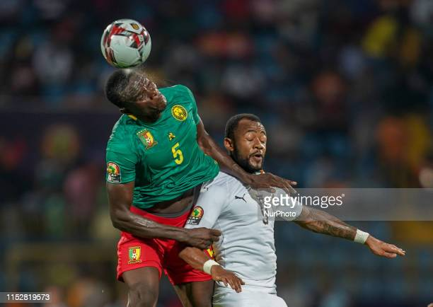 Jordan Pierre Ayew of Ghana and Michael Ngadeu Ngadjui of Cameroon challenging for the ball during the 2019 African Cup of Nations match between...