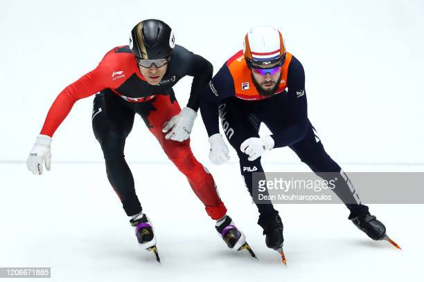 Jordan Pierre-Gilles of Canada and Sjinkie Knegt of Netherlands compete in the Men 5000m Relay Final during the ISU World Cup Short Track at...