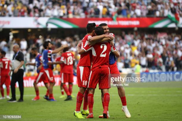 Jordan players ceberate victory over Australia at the end of the AFC Asian Cup Group B match between Australia and Jordan at Hazza Bin Zayed Stadium...