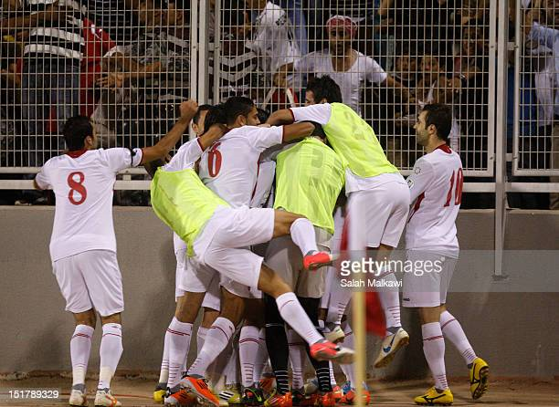 Jordan players celebrate as they win against Australia 21 during their 2014 World Cup group B qualifying football match at King Abdullah Stadium in...