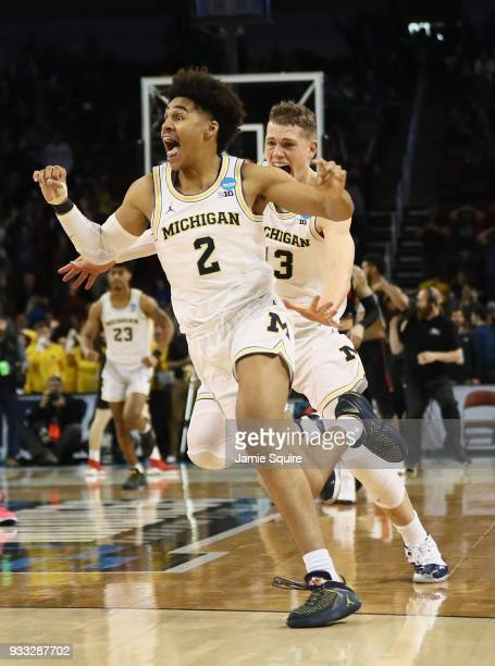 Jordan Poole and Moritz Wagner of the Michigan Wolverines celebrate Poole's 3point buzzer beater for a 6463 win over the Houston Cougars during the...