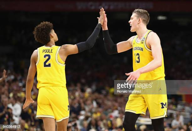 Jordan Poole and Moritz Wagner of the Michigan Wolverines celebrate in the second half against the Loyola Ramblers during the 2018 NCAA Men's Final...
