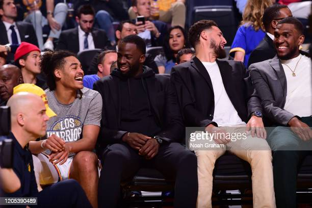 Jordan Poole Draymond Green Klay Thompson and Kevon Looney of the Golden State Warriors shares a laugh on the bench during the game on March 5 2020...