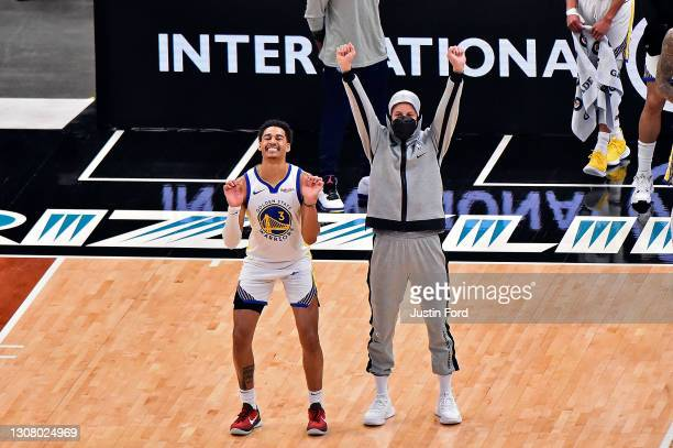 Jordan Poole of the Golden State Warriors and Stephen Curry of the Golden State Warriors during the second half against the Memphis Grizzlies at...