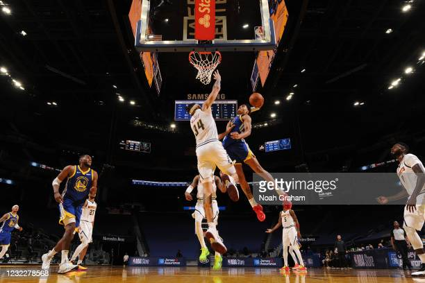 Jordan Poole of the Golden State Warriors dunks the ball during the game against the Denver Nuggets on April 12, 2021 at Chase Center in San...