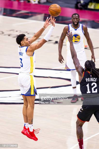Jordan Poole of the Golden State Warriors makes a three point shot during the third quarter of a game against the Cleveland Cavaliers at Rocket...