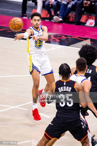 Jordan Poole of the Golden State Warriors passes the ball during the third quarter of a game against the Cleveland Cavaliers at Rocket Mortgage...