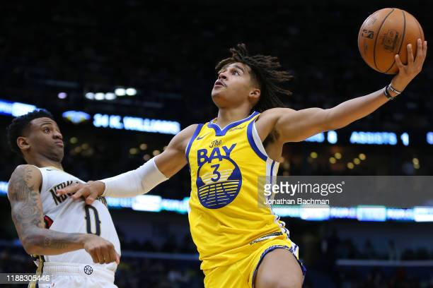 Jordan Poole of the Golden State Warriors shoots against Nickeil AlexanderWalker of the New Orleans Pelicans during the second half of a game at the...