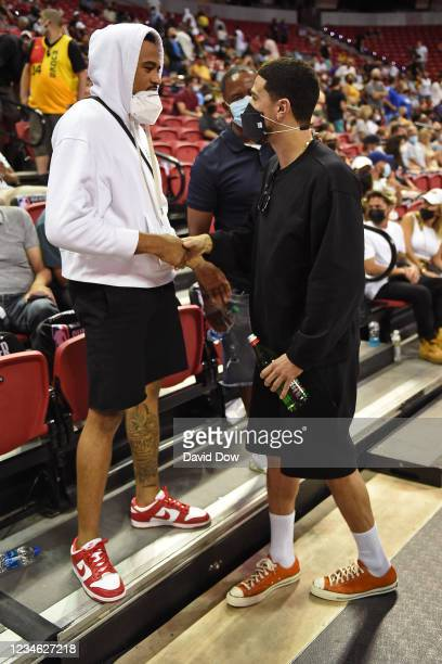 Jordan Poole of the Golden State Warriors talks to Devin Booker of the Phoenix Suns during Day 1 of the 2021 Las Vegas Summer League on August 8,...