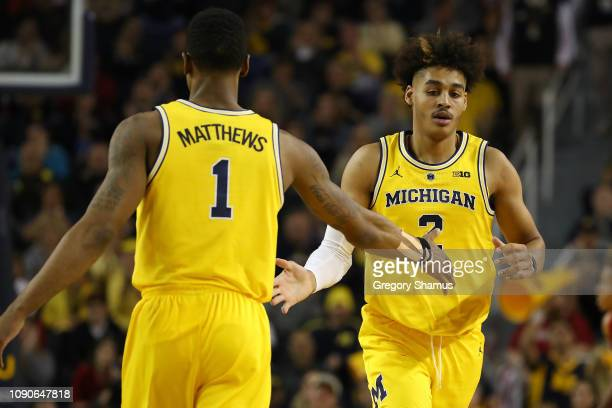 Jordan Poole of the Michigan Wolverines celebrates a second half basket with Charles Matthews while playing the Indiana Hoosiers at Crisler Arena on...