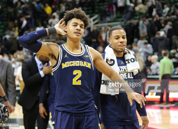Jordan Poole of the Michigan Wolverines celebrates after 8272 win over the Michigan State Spartans at Breslin Center on January 13 2018 in East...
