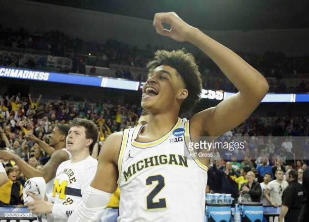 Jordan Poole of the Michigan Wolverines celebrates his 3point buzzer beater for a 6463 win over the Houston Cougars during the second round of the...