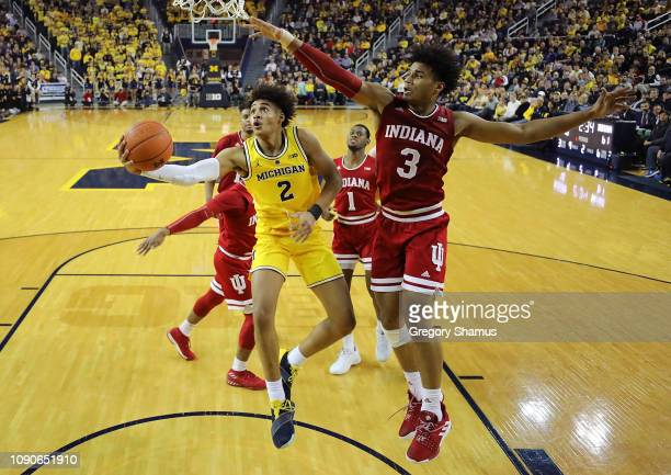 Jordan Poole of the Michigan Wolverines gets a second half shot off around Justin Smith of the Indiana Hoosiers at Crisler Arena on January 06 2019...