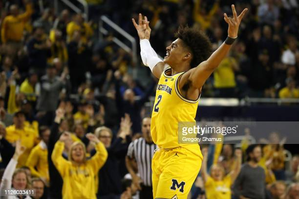 Jordan Poole of the Michigan Wolverines reacts after a second half three point basket while playing the Ohio State Buckeyes at Crisler Arena on...