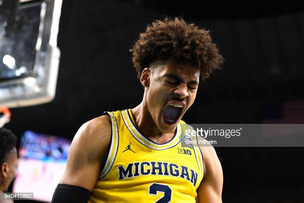 Jordan Poole of the Michigan Wolverines reacts against the Loyola Ramblers during the second half in the 2018 NCAA Men's Final Four semifinal game at...