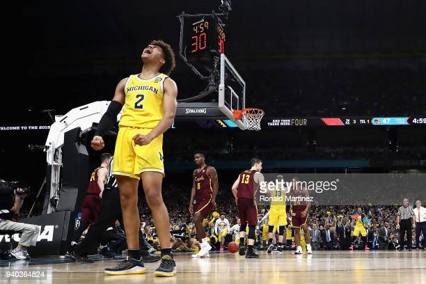 Jordan Poole of the Michigan Wolverines reacts in the second half against the Loyola Ramblers during the 2018 NCAA Men's Final Four Semifinal at the...