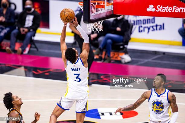 Jordan Poole scores on an assist from Kent Bazemore of the Golden State Warriors during the fourth quarter of a game against the Cleveland Cavaliers...
