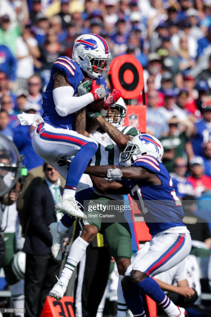 Jordan Poyer #21 of the Buffalo Bills and Robby Anderson #11 of the New York Jets and Tre'Davious White #27 of the Buffalo Bills go for the ball during the fourth quarter against the New York Jets on September 10, 2017 at New Era Field in Orchard Park, New York.
