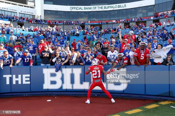 Jordan Poyer of the Buffalo Bills slaps hands with fans after an NFL game against the Miami Dolphins at New Era Field on October 20, 2019 in Orchard...