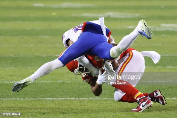 Jordan Poyer of the Buffalo Bills tackles Clyde Edwards-Helaire of the Kansas City Chiefs in the third quarter during the AFC Championship game at...