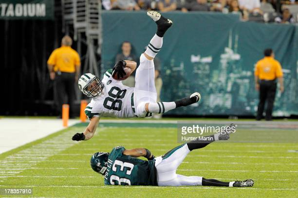 Jordan Poyer of the Philadelphia Eagles tackles Konrad Reuland of the New York Jets during a preseason game on August 29 2013 at MetLife Stadium in...
