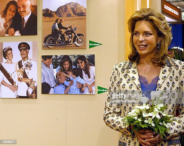 Jordan Queen Noor poses next to some pictures of her family during the presentation of her work Memories Of An Unexpected Life in Madrid 17 September...